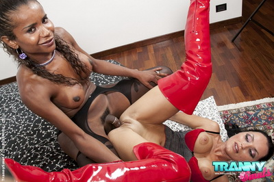 Sexy girl in long red boots fucked by black tranny